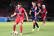 York City midfielder James Barrett watched by Doncaster Rovers midfielder Richard Wellens  during the Johnstone's Paint Trophy match between York City and Doncaster Rovers at Bootham Crescent, York, England on 6 October 2015. Photo by Simon Davies.