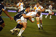 Ben May tackled by Mitchell Chapman.Super 14 rugby union match, Brumbies v Cheifs, Canberra, Australia. Saturday 19 February 2011. Photo: Paul Seiser/PHOTOSPORT.../SPORTZPICS