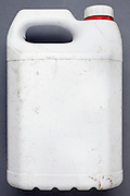a white plastic canister with lost label