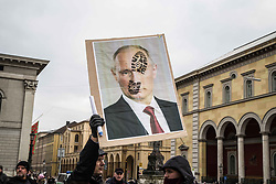 February 18, 2017 - Munich, Germany - Putin face with boot print. Anti-MSC protests organized by far- and radical-rightists under the banner of 'Anti-imperialist Action' with support from the far-right Friedensbewegung bundesweit Koordination (FdK) at the Rindermarkt near the Jewish cultural center at Jakobsplatz. (Credit Image: © Sachelle Babbar via ZUMA Wire)
