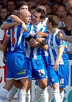 Photo: Ashley Pickering.<br /> Colchester United v Sunderland. Coca Cola Championship. 21/04/2007.<br /> Wayne Brown (L) celebrates with fellow goal scorers Richard Garcia (no. 14) and Jamie Cureton (no. 8) after Colchester beat Sunderland 3-1