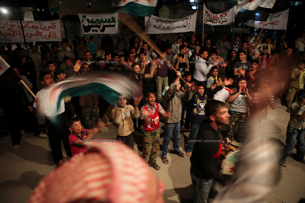 A typically night demonstration in Sarmin. The village of Sarmin near Idlib city came under heavy shelling in march. Many houses were destroyed and dozens of people died when helicopters fired into and the 76. Brigade raided the big village.