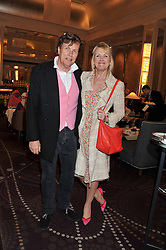 THEO & LOUISE FENNELL at a tea party to held at The Langham Hotel, Portland Place, London with tea inspired by Theo Fennell held on 25th April 2013.