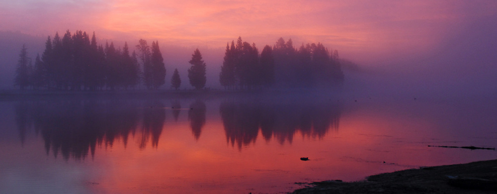 A panoramic view of a colorful autumn sunrise over the Yellowstone River.