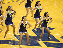 West Virginia dancers perform during a timeout against the Texas Tech Red Raiders during the second half at the WVU Coliseum.