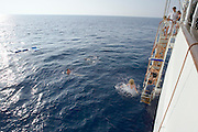 Passengers having a swim at the open Sea.