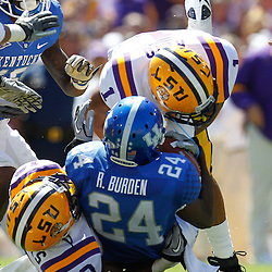 October 1, 2011; Baton Rouge, LA, USA;  LSU Tigers safety Eric Reid (1) and cornerback Ron Brooks (13) tackle Kentucky Wildcats punt returner Randall Burden (24)  during the second quarter at Tiger Stadium.  Mandatory Credit: Derick E. Hingle-US PRESSWIRE / © Derick E. Hingle 2011