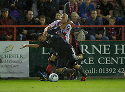 EXETER, ENGLAND - Wednesday, August 24, 2011: Liverpool's Luis Alberto Suarez Diaz in action against Exeter City's James Dunne during the Football League Cup 2nd Round match at St James Park. (Pic by David Rawcliffe/Propaganda)