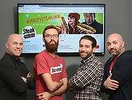 From left, Jesse Bender, Account Manager, Nathan Allebach, Social Media Manager, Christian Betlyon, Digital Strategist, and Joey Piazza, Director of Marketing for Quaker Made Meats stand in front of a monitor with the Twitter account for Steakumm visible on screen at Allebach Communications Tuesday December 19, 2017 in Souderton, Pennsylvania. The Montgomery County marketing firm is trying to have the Steam Twitter account verified with viral success. (WILLIAM THOMAS CAIN / For The Philadelphia Inquirer)