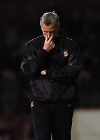 West Ham manager Alan Pardew contemplates his teams defeat. Credit: Back Page Images / Matthew Impey. West Ham United v Sheffield United, The Coca Cola Championship, 3/01/2004.