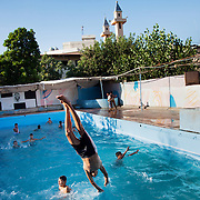 In Ein El-Hilweh refugee camp, home to 75.000 Palestinians. The pool in Ein El-Hilweh refugee camp. Developmental Action Without Borders(Naba'a) work in Palestinian refugee camps across Lebanon to help children in the camps.  The camps are densely over-crowded and many of the children are 4th generation refugees living in Lebanon with no citizenship or rights and under immense pressure. Naba'a is a mix of Palestinians and Lebanese and aim to give children a sense of security and freedom to express their needs and rights.Naba'a operates in communities governed by a multitude of political parties and religious groups and Naba'a keeps a strict independed line from any affiliation with any groups.