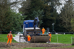 Denham, UK. 4 February, 2020. Engineers working on the HS2 high-speed rail link project prepare to unload a temporary roadway from a large truck. Planned works in the immediate vicinity are believed to include the felling of 200 trees and the construction of a roadway, Bailey bridge, compounds, fencing and a parking area. Credit: Mark Kerrison/Alamy Live News