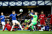Everton defender Lucas Digne (12) and Everton goalkeeper Jordan Pickford (1) deal with the attack from Liverpool midfielder Fabinho (3) during the Premier League match between Everton and Liverpool at Goodison Park, Liverpool, England on 3 March 2019.