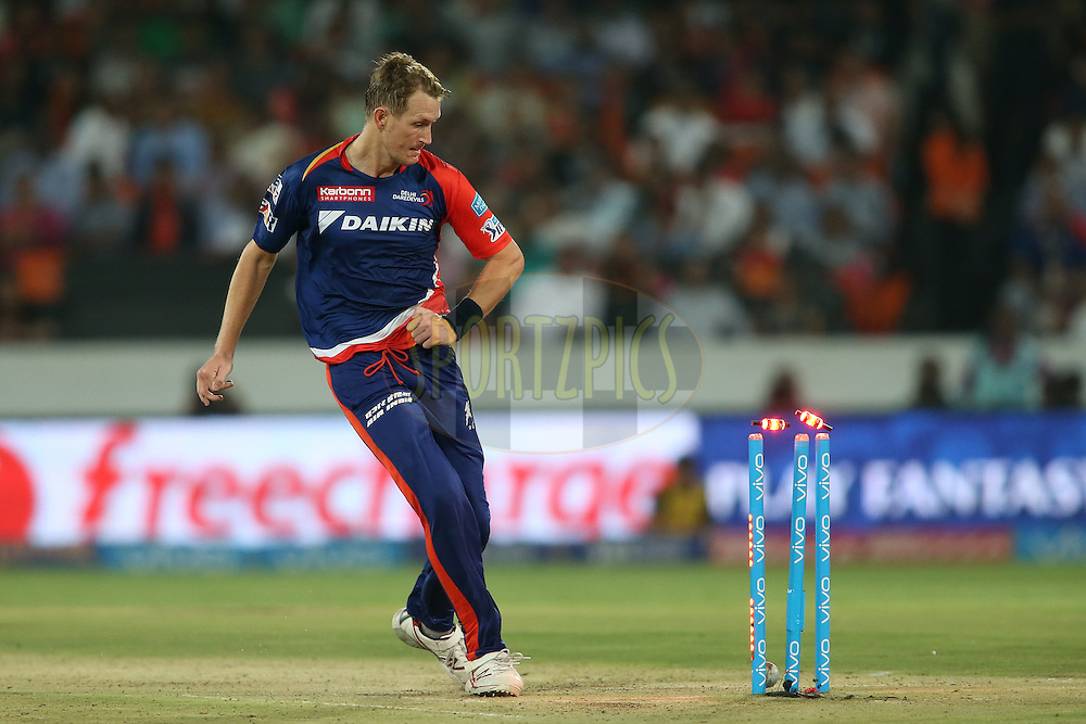 Christopher Morris of Delhi Daredevils kicks the ball onto the stumps to run out Bhuvneshwar Kumar of Sunrisers Hyderabad during match 42 of the Vivo IPL 2016 (Indian Premier League) between the Sunrisers Hyderabad and the Delhi Daredevils held at the Rajiv Gandhi Intl. Cricket Stadium, Hyderabad on the 12th May 2016<br /> <br /> Photo by Shaun Roy / IPL/ SPORTZPICS