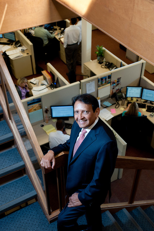 Environmental portrait of Leader Bank CEO Sushil Tuli taken in bank's offices in Arlington, MA.