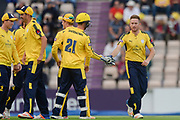 Liam Dawson of Hampshire is congratulated by team mates after dismissing Steven Davies of Somerset during the NatWest T20 Blast South Group match between Hampshire County Cricket Club and Somerset County Cricket Club at the Ageas Bowl, Southampton, United Kingdom on 18 August 2017. Photo by Dave Vokes.