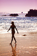 Silhouette of Woman Walking on Beach