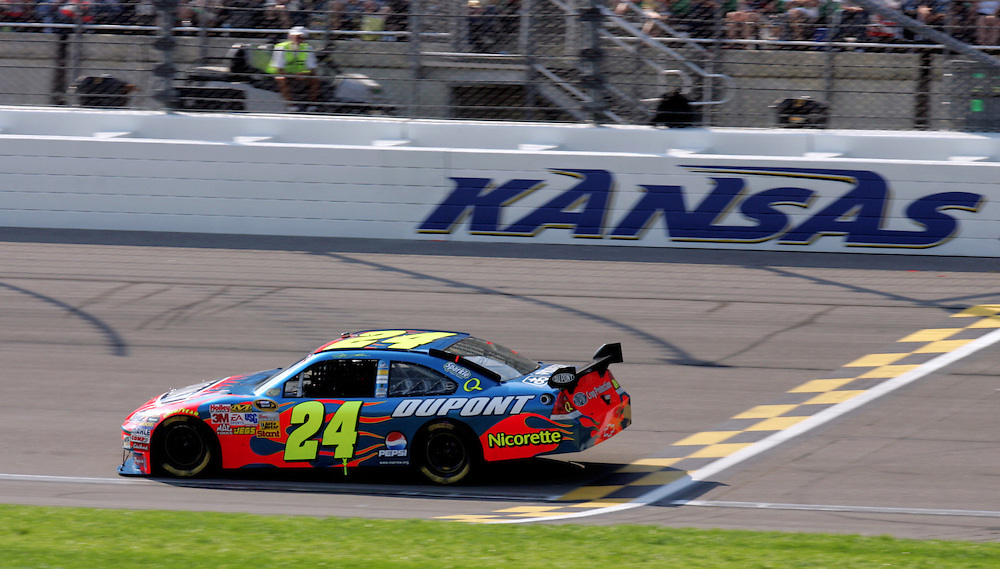 September 28, 2008; Kansas City, KS, USA; NASCAR Sprint Cup Series driver Jeff Gordon crosses the finish line during the Camping World RV 400 at Kansas Speedway. Mandatory Credit: Douglas Jones-US PRESSWIRE