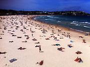 Beachgoers on a sunny day at Bondi Beach, Sydney Australia