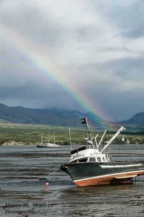 Rainbow over fishing boats in Chignik Lagoon at low tide; Chignik Lagoon (Alutiiq village);Alaska Peninsula;Aleutian Range;Alaska