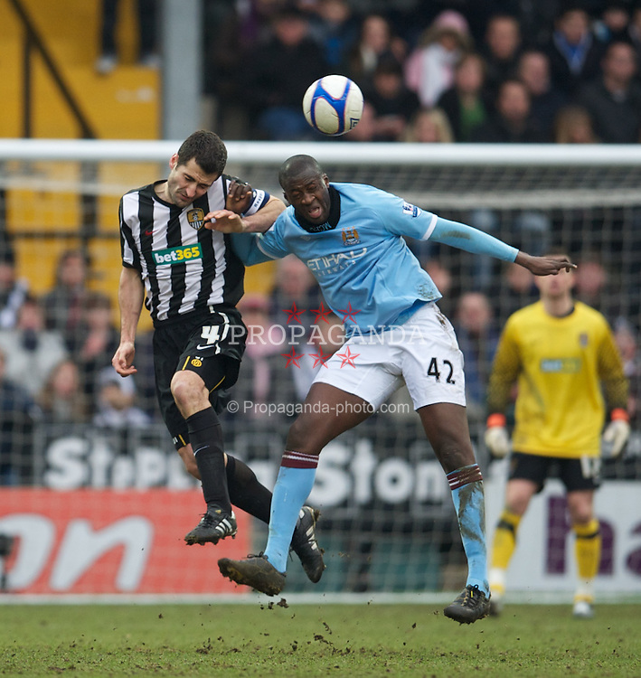 NOTTINGHAM, ENGLAND - Sunday, January 30, 2011: Manchester City's Yaya Toure and Notts County's captain Mike Edwards during the FA Cup 4th Round match at Meadow Lane. (Photo by David Rawcliffe/Propaganda)
