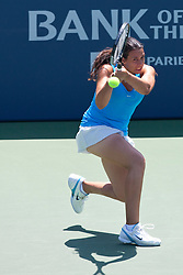 July 31, 2011; Stanford, CA, USA;  Marion Bartoli (FRA) returns the ball against Serena Williams (USA), not pictured, during the finals of the Bank of the West Classic women's tennis tournament at the Taube Family Tennis Stadium.