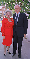 LORD & LADY YOUNG OF GRAFFHAM at a party in London on 30th June 1999.MTY 23