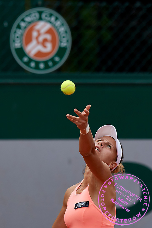 Paris, France - 2017 June 02: Magda Linette from Poland serves while her women's double match second round during tennis Grand Slam tournament The French Open 2017 (also called Roland Garros) at Stade Roland Garros on June 02, 2017 in Paris, France.<br /> <br /> Mandatory credit:<br /> Photo by &copy; Adam Nurkiewicz<br /> <br /> Adam Nurkiewicz declares that he has no rights to the image of people at the photographs of his authorship.<br /> <br /> Picture also available in RAW (NEF) or TIFF format on special request.<br /> <br /> Any editorial, commercial or promotional use requires written permission from the author of image.
