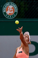 Paris, France - 2017 June 02: Magda Linette from Poland serves while her women's double match second round during tennis Grand Slam tournament The French Open 2017 (also called Roland Garros) at Stade Roland Garros on June 02, 2017 in Paris, France.<br /> <br /> Mandatory credit:<br /> Photo by © Adam Nurkiewicz<br /> <br /> Adam Nurkiewicz declares that he has no rights to the image of people at the photographs of his authorship.<br /> <br /> Picture also available in RAW (NEF) or TIFF format on special request.<br /> <br /> Any editorial, commercial or promotional use requires written permission from the author of image.