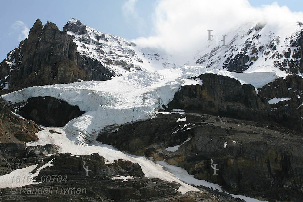 Alpine glacier overflows from Columbia Icefield down Mount Andromeda in Jasper National Park, Alberta, Canada.
