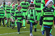 Ambassadors walk out with the team during the EFL Sky Bet League 2 match between Forest Green Rovers and Crewe Alexandra at the New Lawn, Forest Green, United Kingdom on 22 December 2018.