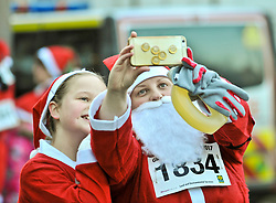 Laura and Olivia Scott from Glasgow take a quick selfie before more than 8000 runners, all dressed as Santa, took part in the annual charity fun run thru the centre of Glasgow, to raise money for charity.<br /> <br /> © Dave Johnston/ EEm