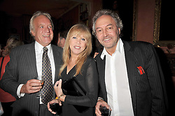 Left to right, JOHN RENDALL, PATTI BOYD and ROD WESTON at a party to celebrate the publication of 'A Lion called Christian' held at 36 Chapel Street, London SW1 on 26th March 2009.