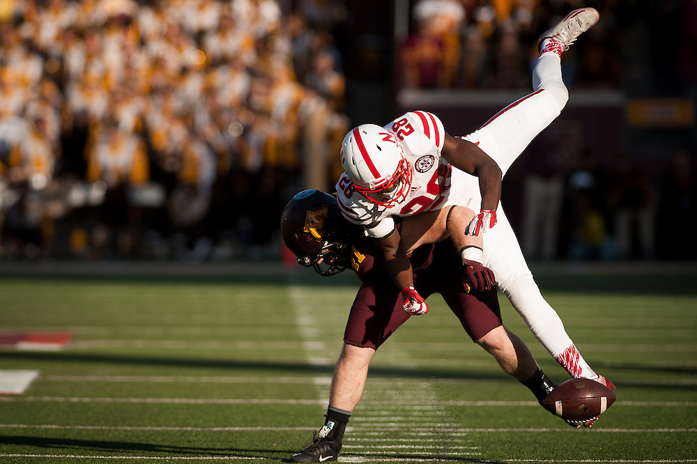 Wide receiver Alonzo Moore #82 of the Nebraska Cornhuskers has the ball knocked away by fullback Miles Thomas #41 of the Minnesota Golden Gophers during their game at TCF Bank Stadium on October 17, 2015 in Minneapolis Minnesota. Nebraska defeated Minnesota 48-25. Photo by Eric Francis
