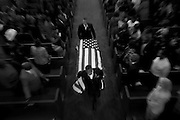 The flag draped casket of Rev. Daniel Lee Simmons, a Vietnam Veteran, is carried out of church following his funeral service on June 30, 2015. Simmons was the final member of the Emanuel Nine to be laid to rest.