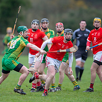 Eire Og's Rory Gallagher is blocked by O'Callaghan's Mills's Coloin Crehan