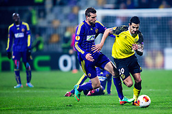 Vitolo of Sevilla and Zeljko Filipovic #5 of Maribor during football match between NK Maribor and Sevilla FC (ESP) in 1st Leg of Round of 32 of UEFA Europa League 2014 on February 20, 2014 at Stadium Ljudski vrt, Maribor, Slovenia. Photo by Matic Klansek Velej / Sportida