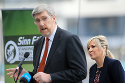 © Licensed to London News Pictures. 31/01/2017. Belfast, Northern Ireland, UK. Sinn Féin's leader in the north of Ireland, Michelle O'Neill listens to their party's Brexit spokesperson John O'Dowd during a news conference in Belfast's Waterfront Hall. Sinn Féin were launching its document 'The Case for the North to achieve Designated Special Status Within the EU' on the day Westminister debate Brexit. Photo credit : Paul McErlane/LNP