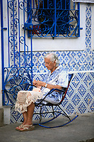 old woman sewing on a rocking chair in olinda near recife pernambuco state brazil