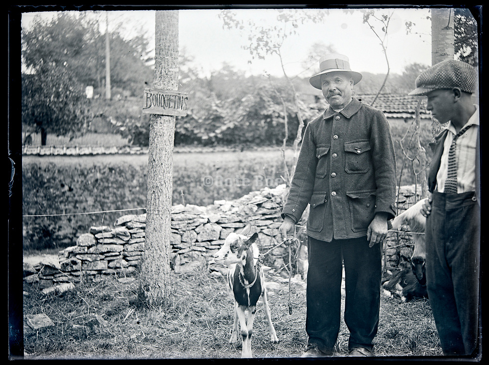 goat farmer with animal circa 1930s France