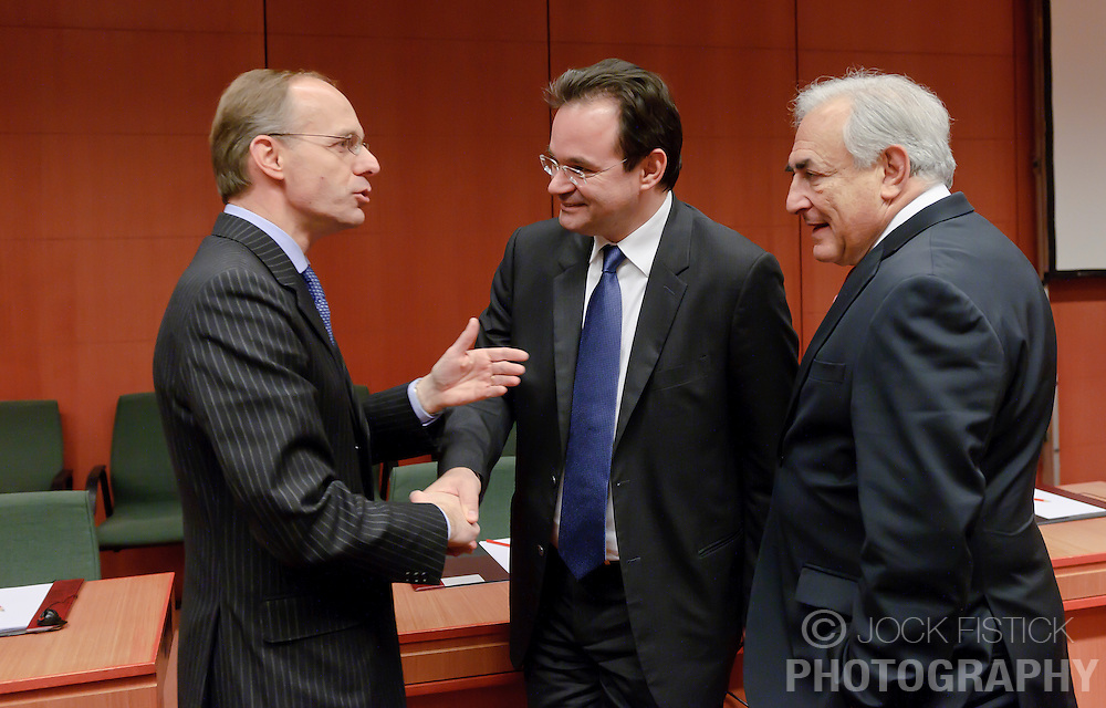 Luc Frieden, Luxembourg's finance minister, left, speaks with George Papaconstantinou, Greece's finance minister, center, and Dominique Strauss-Kahn, managing director of the IMF, right, during the Eurogroup meeting in Brussels, Monday Dec. 6, 2010. (Photo © Jock Fistick)