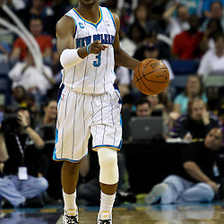 April 3, 2011; New Orleans, LA, USA; New Orleans Hornets point guard Chris Paul (3) returned to the court wearing a knee brace following an injury during the second quarter against the Indiana Pacers at the New Orleans Arena.    Mandatory Credit: Derick E. Hingle