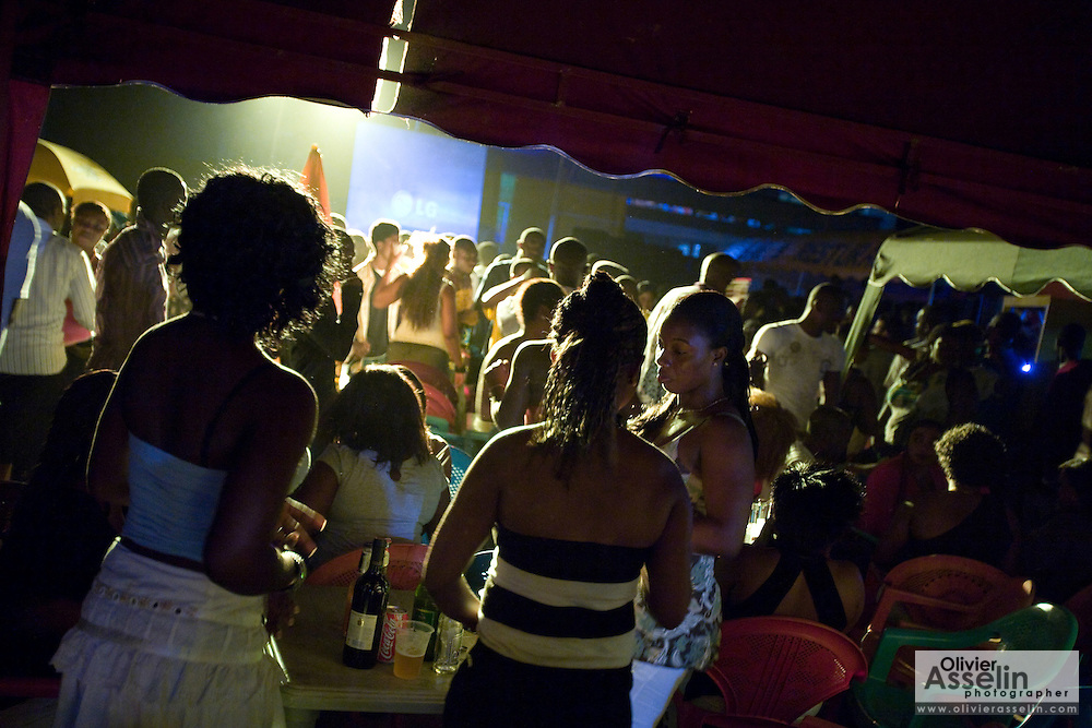 Revelers gather at a party held outside a gas station during the annual Oguaa Fetu Afahye Festival in Cape Coast, Ghana on Friday September 5, 2008.