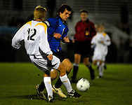 19 NOV. 2020 -- FENTON, Mo. -- St. Louis University High School soccer player Brian Bement (14) battles St. John Vianney High School's David Schallom (12) during the MSHSA Class 3 state soccer semifinal at the A-B Center in Fenton, Mo. Friday, Nov. 19, 2010. Vianney topped SLUH 2-0 to advance to the state title game on Saturday. Image © copyright 2010 Sid Hastings.
