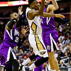 Jan 28, 2016; New Orleans, LA, USA; New Orleans Pelicans guard Norris Cole (30) shoots over Sacramento Kings forward Omri Casspi (18) and guard Ben McLemore (23) during the second half of a game at the Smoothie King Center. The Pelicans defeated the Kings 114-105. Mandatory Credit: Derick E. Hingle-USA TODAY Sports