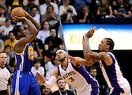 Apr 5, 2013; Phoenix, AZ, USA; Golden State Warriors forward Harrison Barnes (49) goes to put up a shot against the Phoenix Suns forward Jared Dudley (3) and forward Michael Beasley (0) in the second half at US Airways Center. The Warriors defeated the Suns 111-107. Mandatory Credit: Jennifer Stewart-USA TODAY Sports