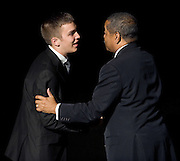 Ohio University student Keller Taylor receives a congratulatory hand shake from Ohio Univeristy President, Rodney McDavis after being named New Student Trustee during the 26th Annual Leadership Awards Gala held at Ohio University Wednesday.