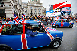 © Licensed to London News Pictures. 01/01/2017. London, UK. Mini cars with union flags participate in London's New Year's Day Parade, the event is one of the world's great street spectaculars with up to 10,000 performers from around the world and hosts marching bands, cheerleaders, leading companies, unions and local boroughs celebrating the arrival of 2017. Photo credit: Tolga Akmen/LNP