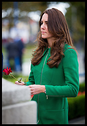 The Duke and Duchess of Cambridge lay red roses at the War Memorial in the town of  Cambridge in New Zealand, Friday, 11th April 2014. Picture: i-Images UK OUT for 28 days from date of creation