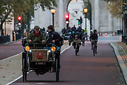 An !895 Peugeot, Passing Buckinham Palace and the Mall - Bonhams London to Brighton Veteran Car Run celebrates the 122nd anniversary of the original Emancipation Run of 1896 which celebrated the passing into law the Locomotives on the Highway Act so raising the speed limit for 'light automobiles' from 4mph to 14mph and abolishing the need for a man to walk in front of all vehicles waving a red flag. The Movember Foundation as our Official Charity Partner.